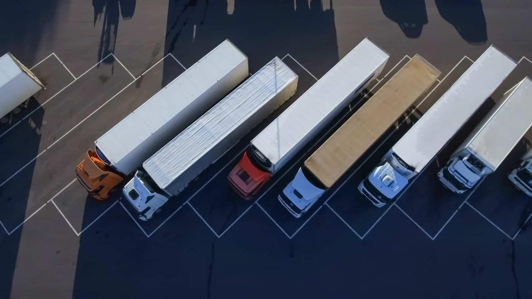 birds eye view of trucks in line
