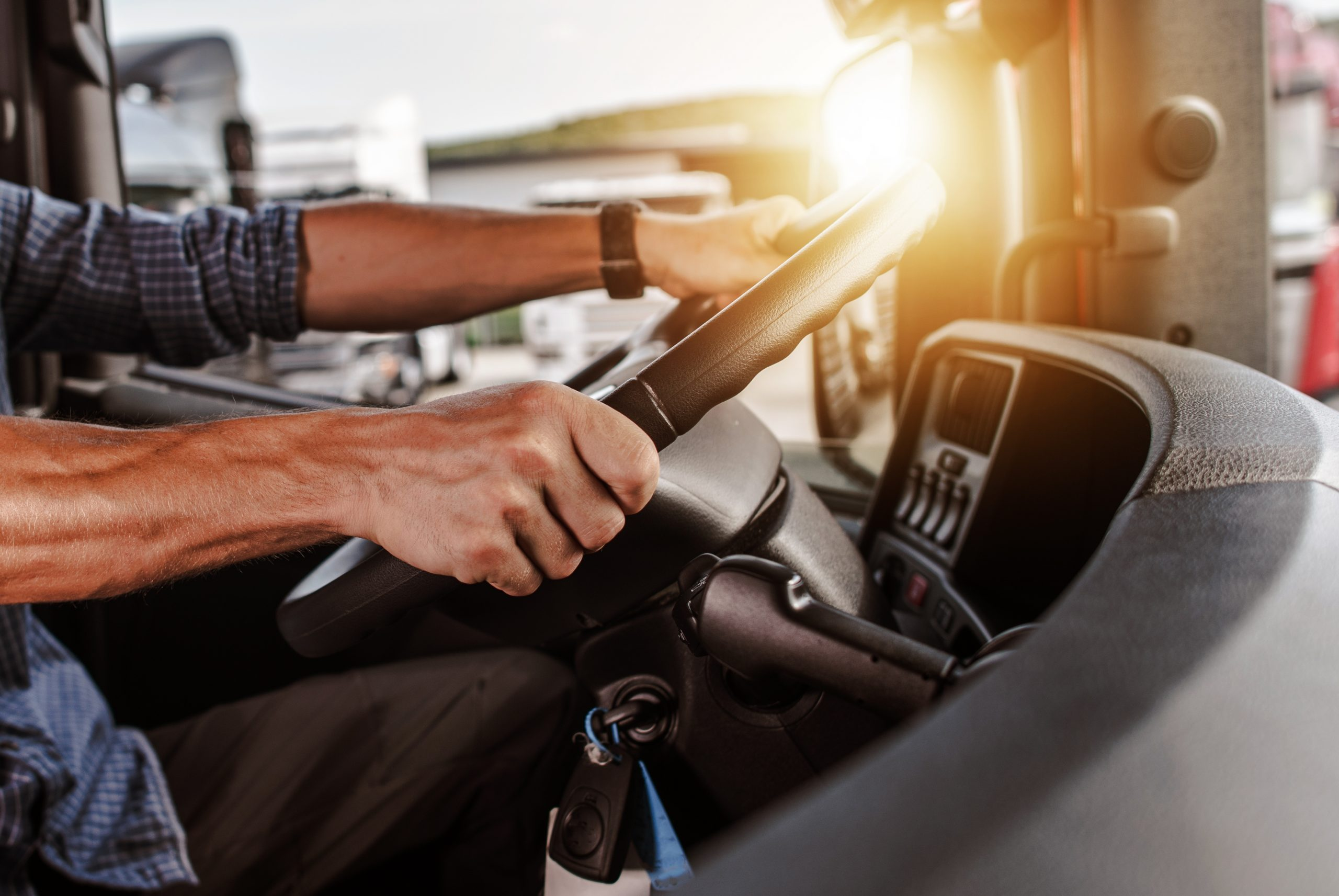 Truck driver hands on steering wheel   close