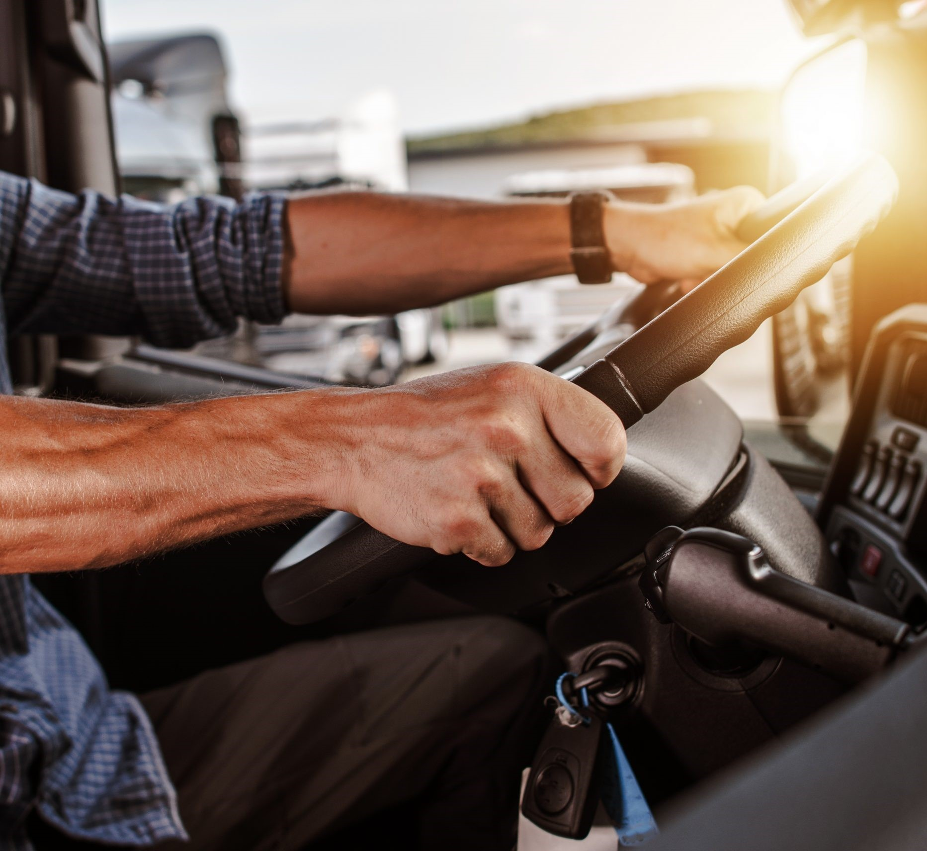 Truck driver hands on steering wheel close scaled